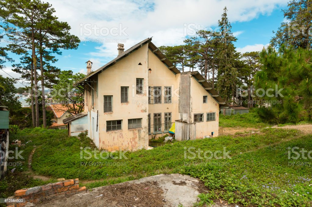 Old empty and abandoned house, ancient house with impression stone wall Vietnam city of Da lat stock photo
