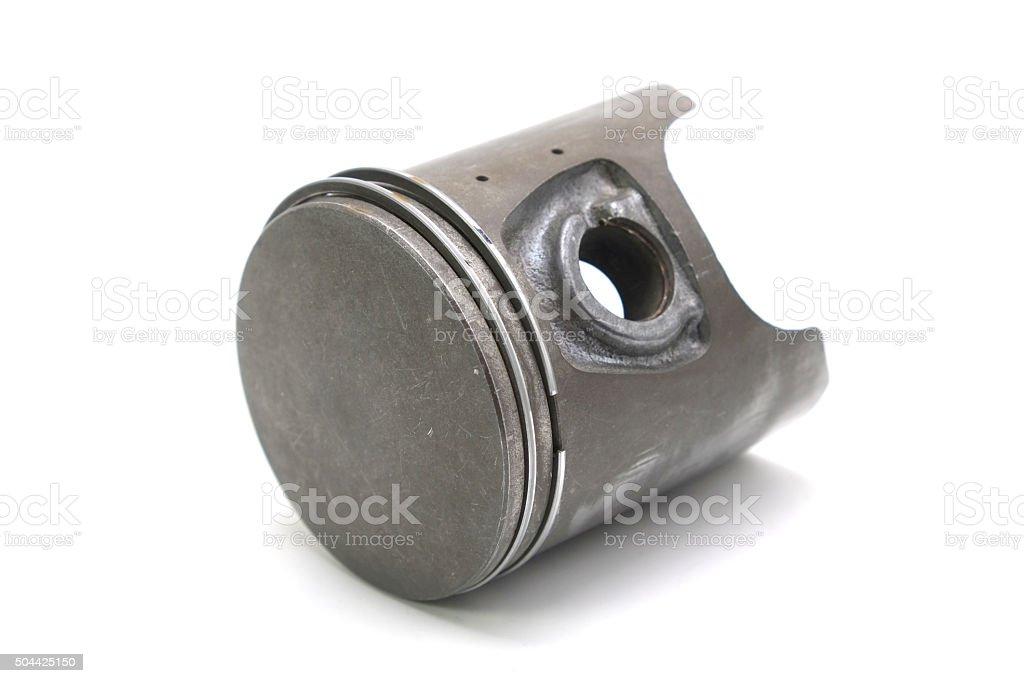 Old engine piston isolated on white background stock photo