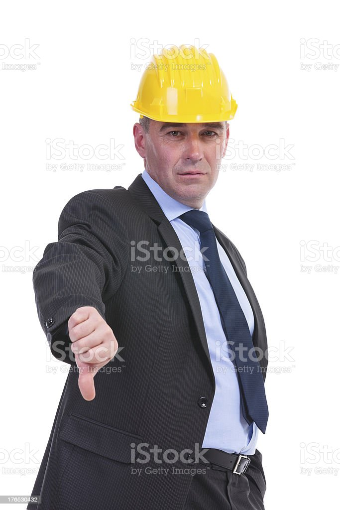 old engineer shows thumb down royalty-free stock photo