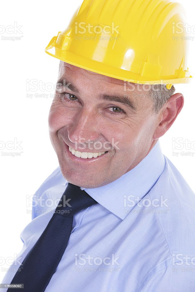 old engineer smiles for the camera royalty-free stock photo
