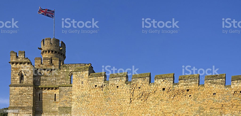 Old english city wall with union jack flag stock photo