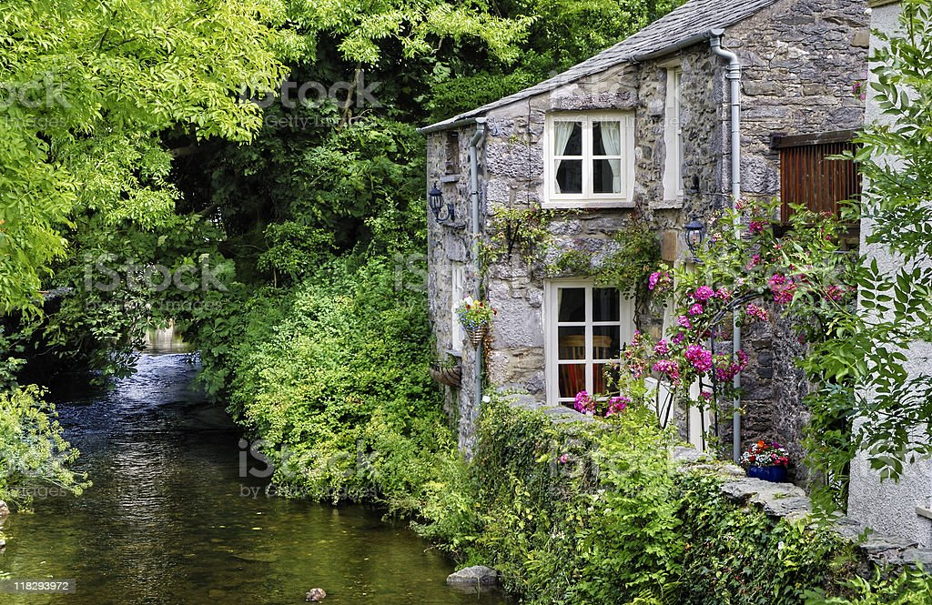 Old English cottage on river stock photo