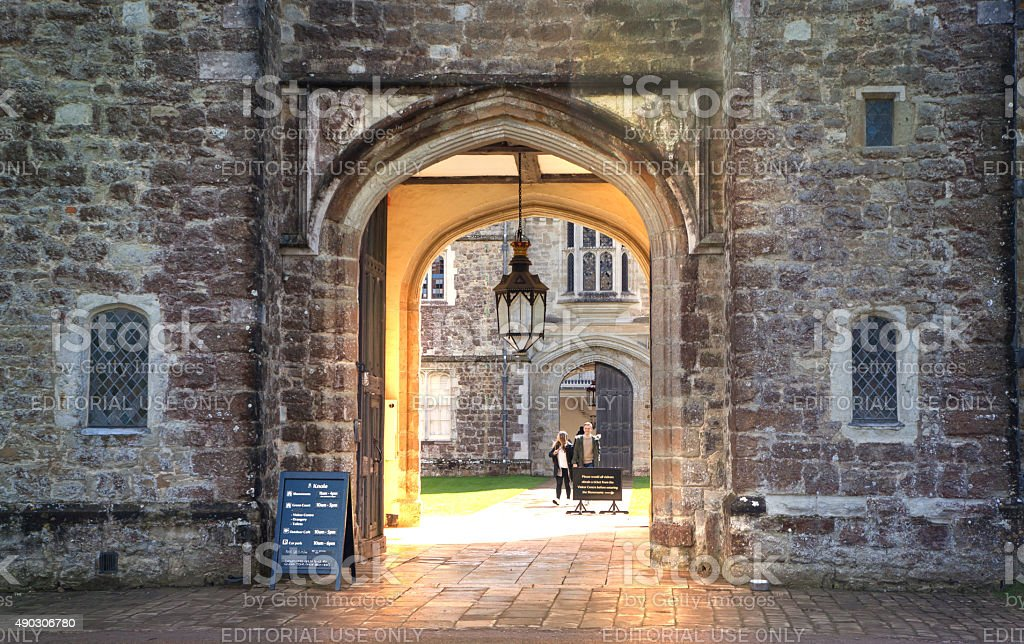 Old english mansion 15th century main entrance with tourists stock photo