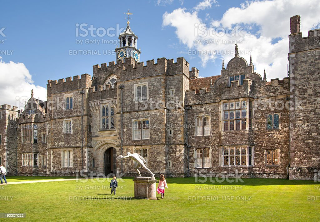 Old english mansion 15th century with little kids playing around stock photo