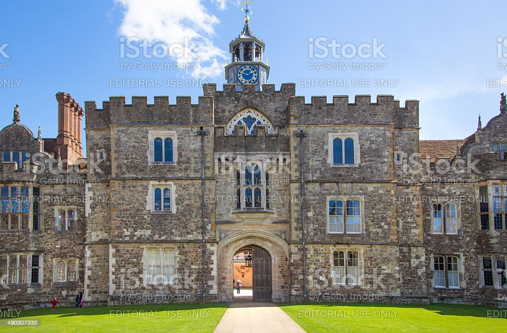Old english mansion 15th century with tourist at the background stock photo
