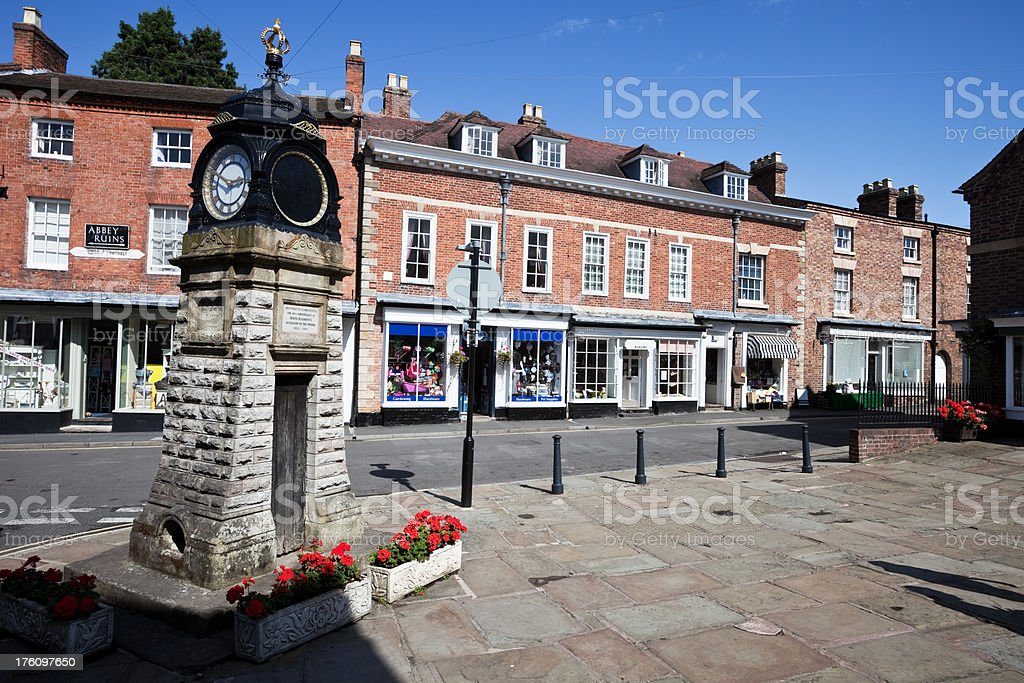 Old English Shops and Town Clock royalty-free stock photo