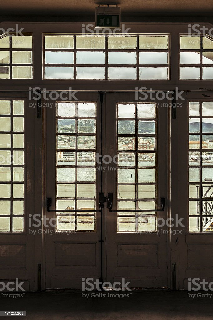 Old entrance at the main dock of Trieste, Italy royalty-free stock photo