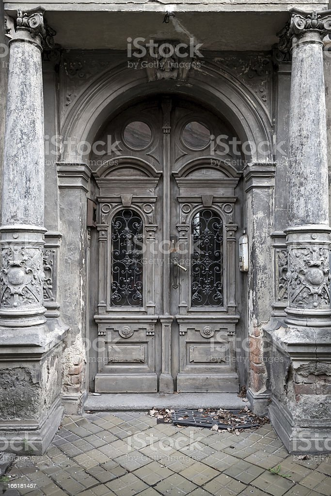 Old entrance door on historic building royalty-free stock photo