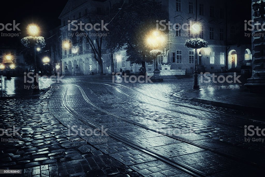 Old European city at rainy night stock photo