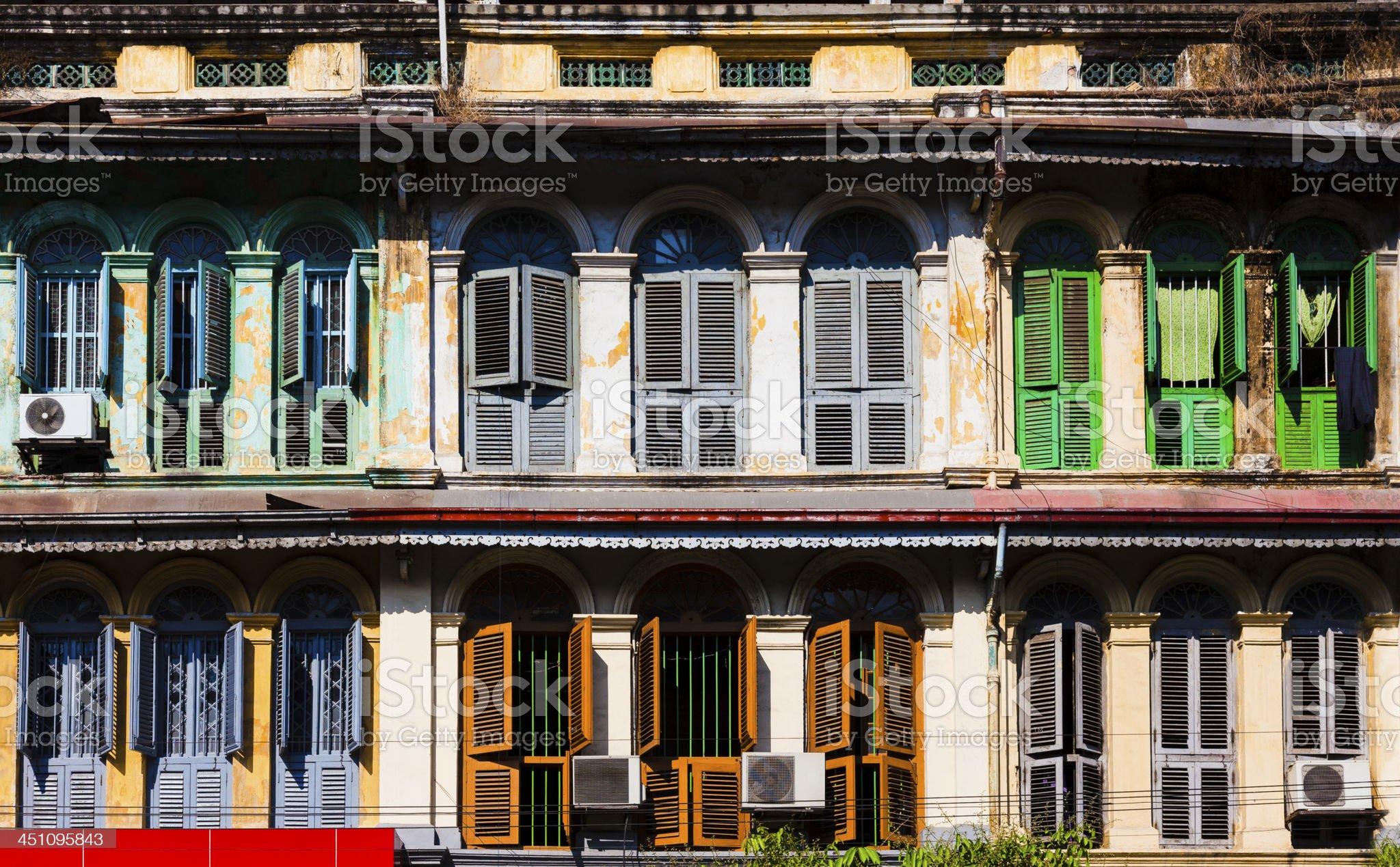 Old European style windows in yangon, Myanmar royalty-free stock photo