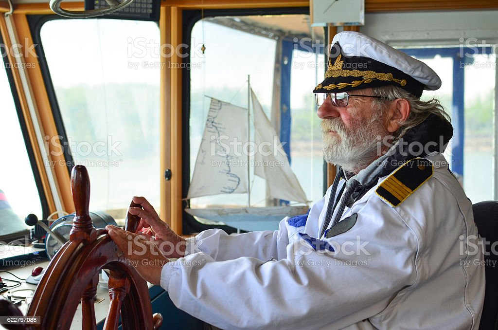 Old experienced captain in navigation cabine stock photo