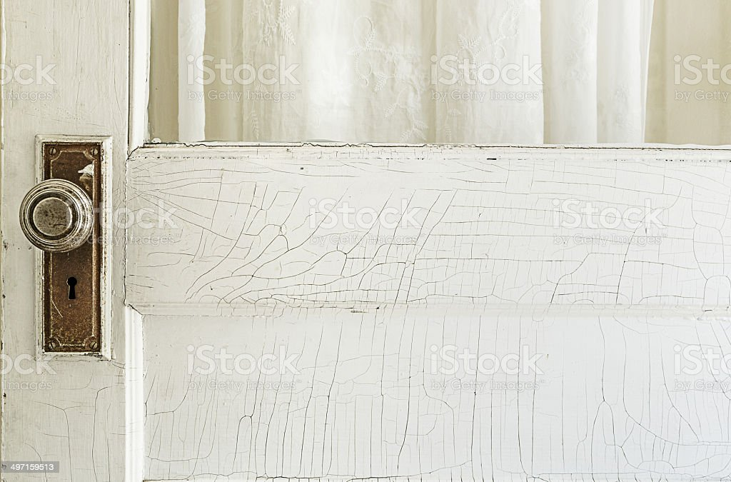 Old Exterior Door with Cracked White Paint stock photo
