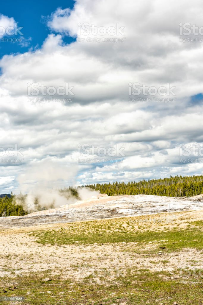 Old Faithful Geyser waiting to erupt in Yellowstone National Park stock photo