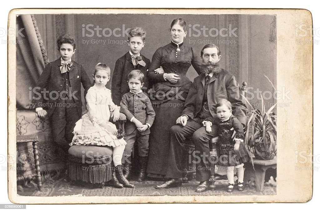old family photo. parents with five children stock photo