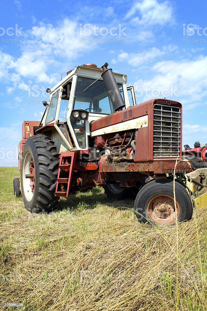 Old Farm Tractor in Grass Field royalty-free stock photo