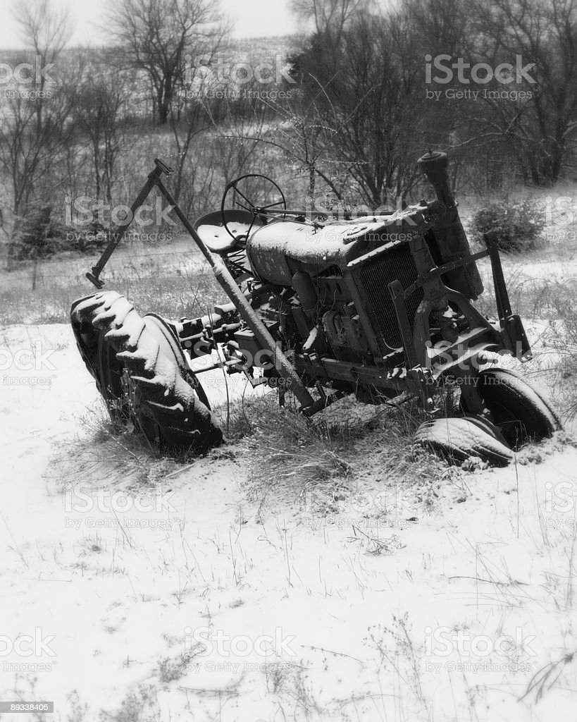 Old Farm Tractor in Winter royalty-free stock photo