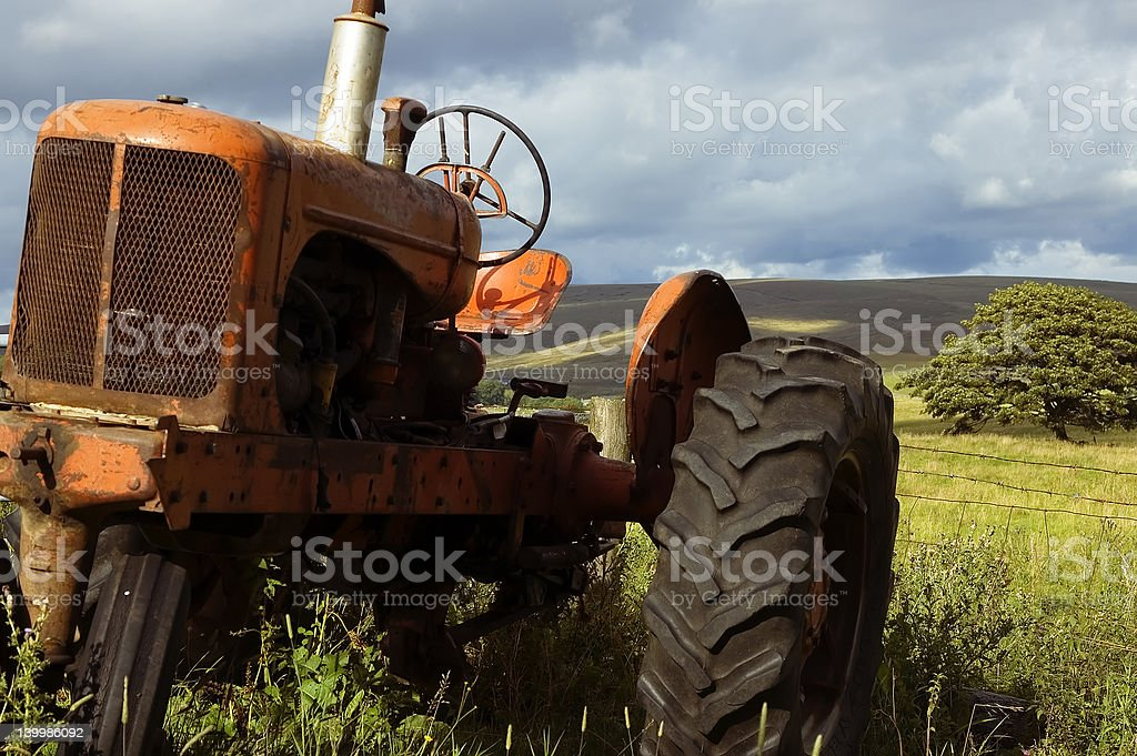 old farm tractor royalty-free stock photo