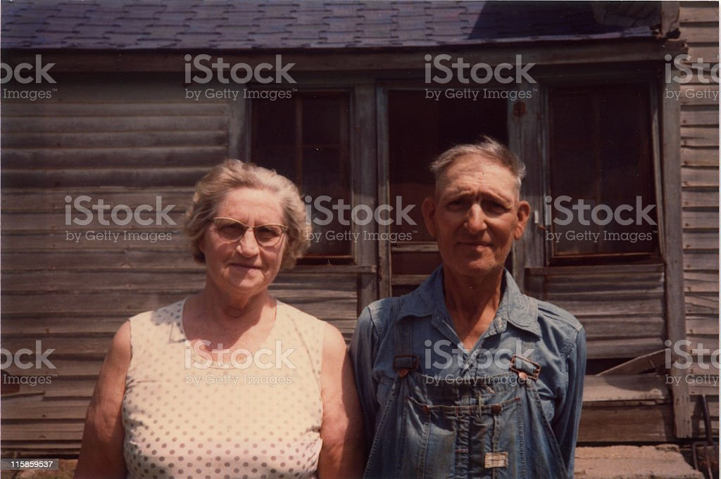 old farmer and his wife, retro stock photo