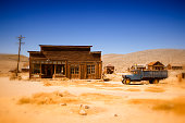 old farmhouse and truck in the desert of California