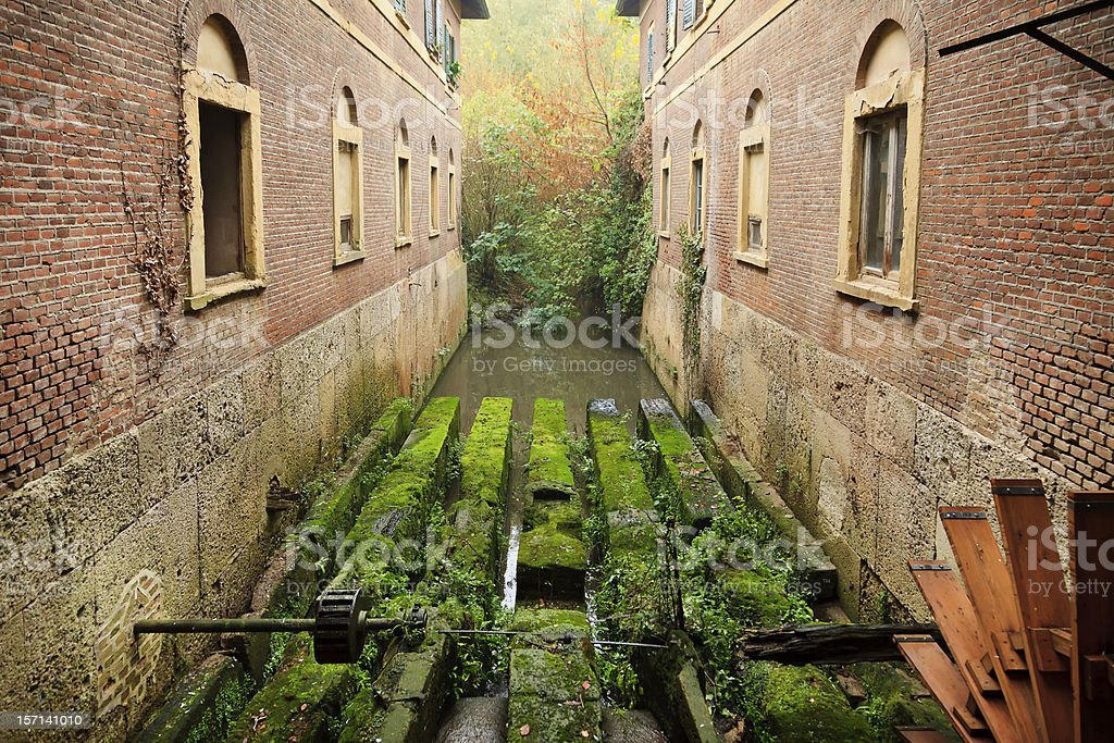 Old farmhouse upon the river stock photo
