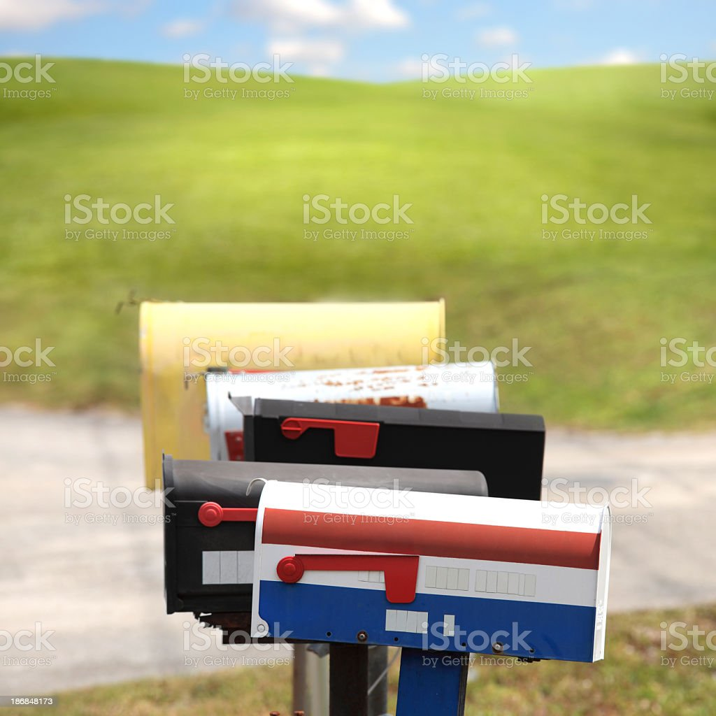 old fashion mailboxes in a row royalty-free stock photo
