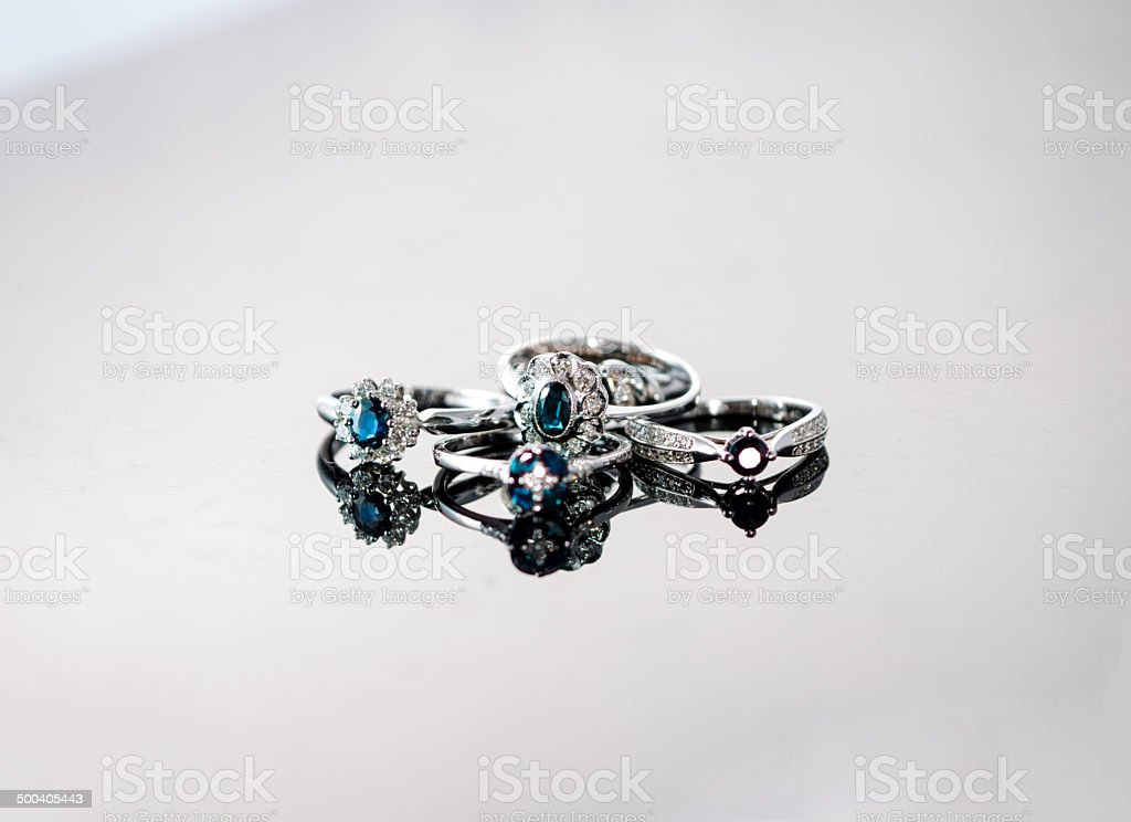 Old fashion rings on reflective background royalty-free stock photo
