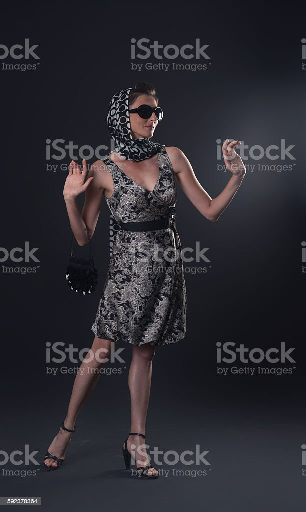 Old Fashion Woman in black background stock photo