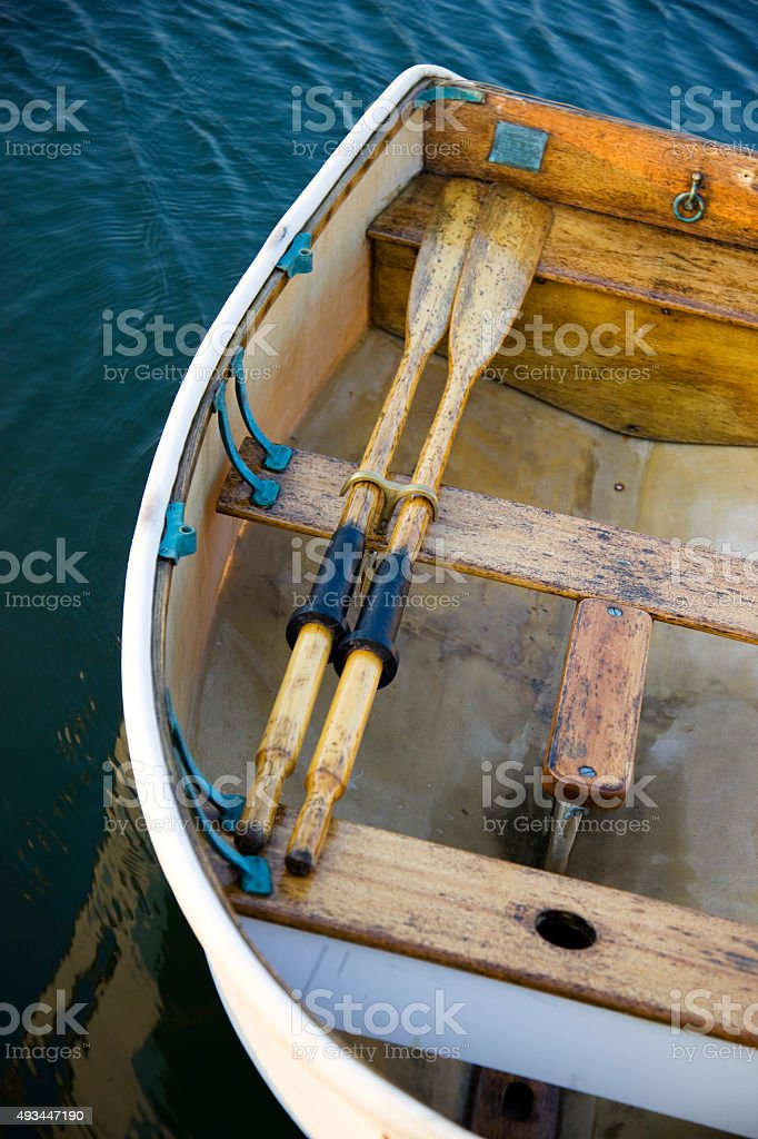 Old fashion wooden row boat stock photo