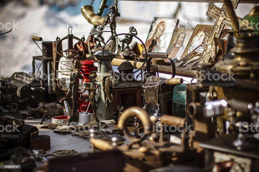 Old fashioned  antique decorative items on the Kiev's flea marke stock photo