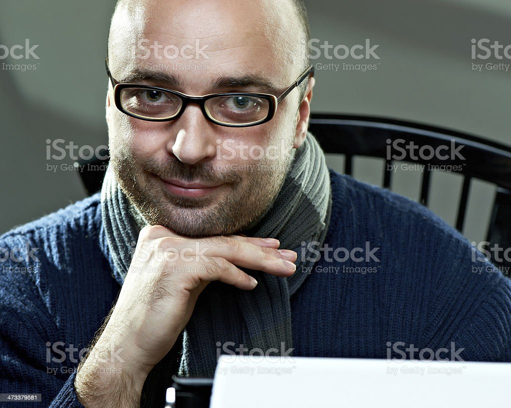 Old fashioned bald writer in glasses stock photo