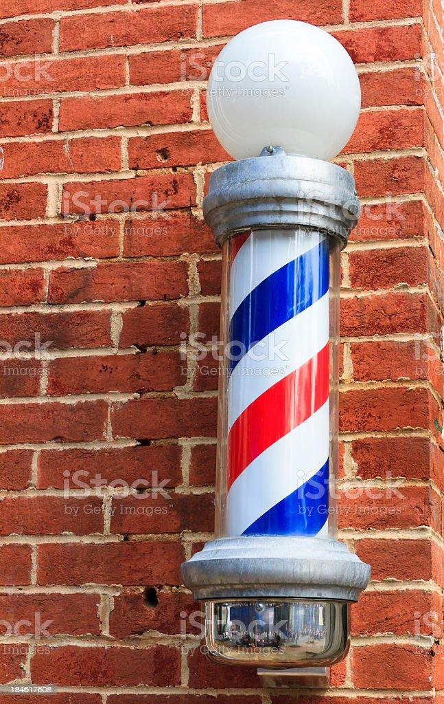 Old Fashioned Barbershop Pole On Brick Wall stock photo