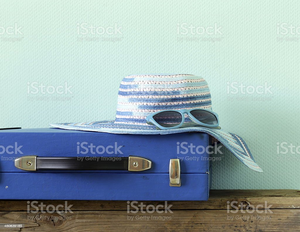old fashioned blue suitcase for travel and beach hat royalty-free stock photo