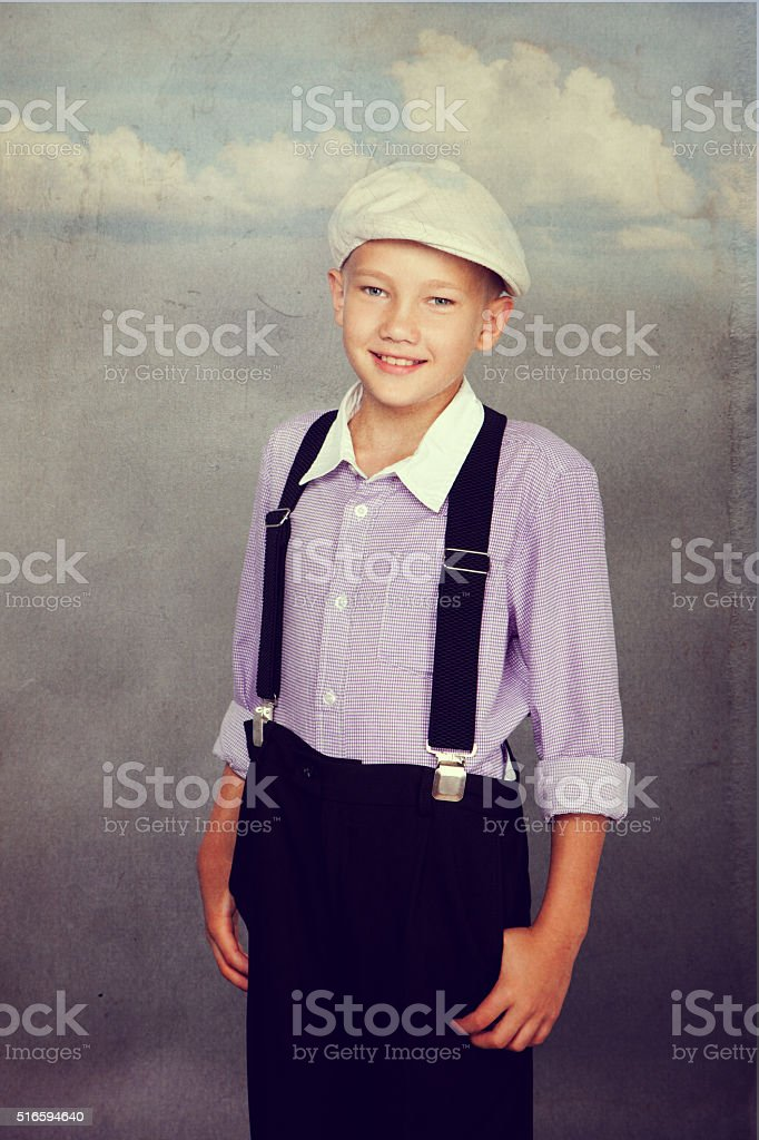 Old fashioned boy looking to the camera stock photo