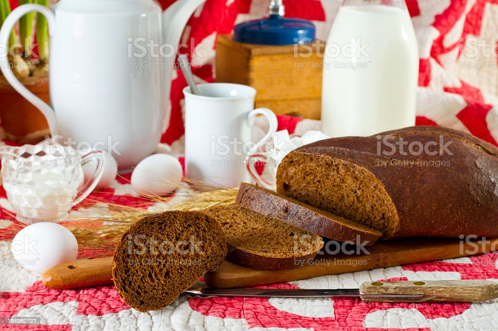 Old fashioned Breakfast Ingredients On Vintage Quilt stock photo