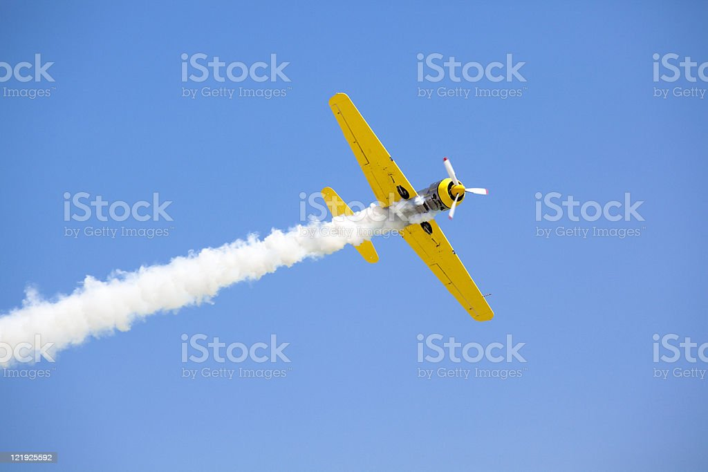 Old fashioned bright yellow propeller plane in sky royalty-free stock photo