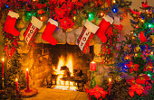 Old fashioned Christmas Rock Fireplace and Poinsettias (P)
