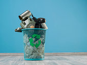 Old Fashioned Communication Tools In Trash Can On Turquoise Wall