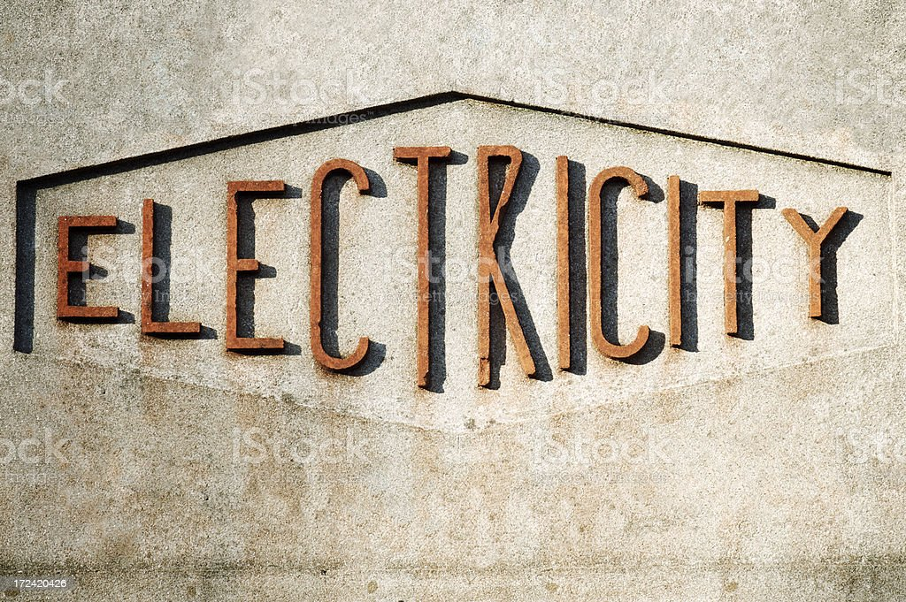 Old Fashioned Electricity Sign on Textured Wall royalty-free stock photo