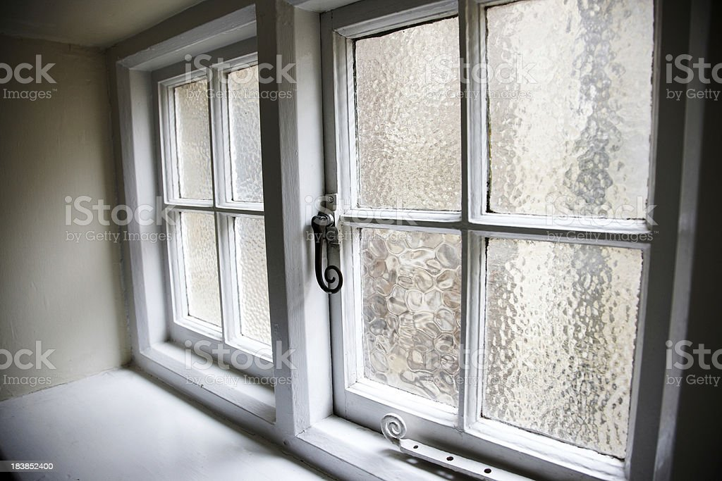 fashioned frosted glass bathroom window stock photo