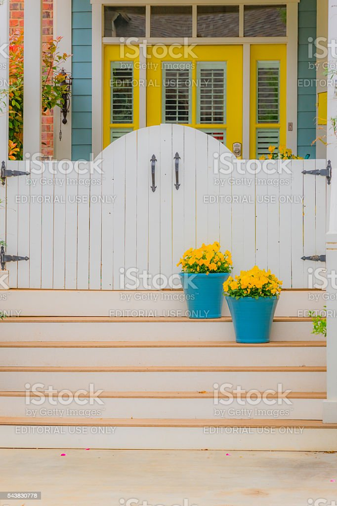 Old fashioned home front porch, steps, flowers, door(P) stock photo