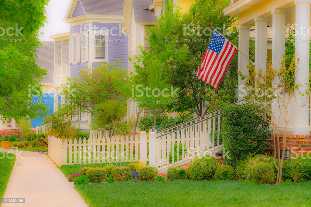 Old fashioned home town street with American Flag (P) stock photo