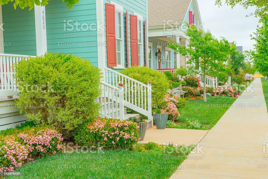Old fashioned home town street with gardens and porches (P) stock photo