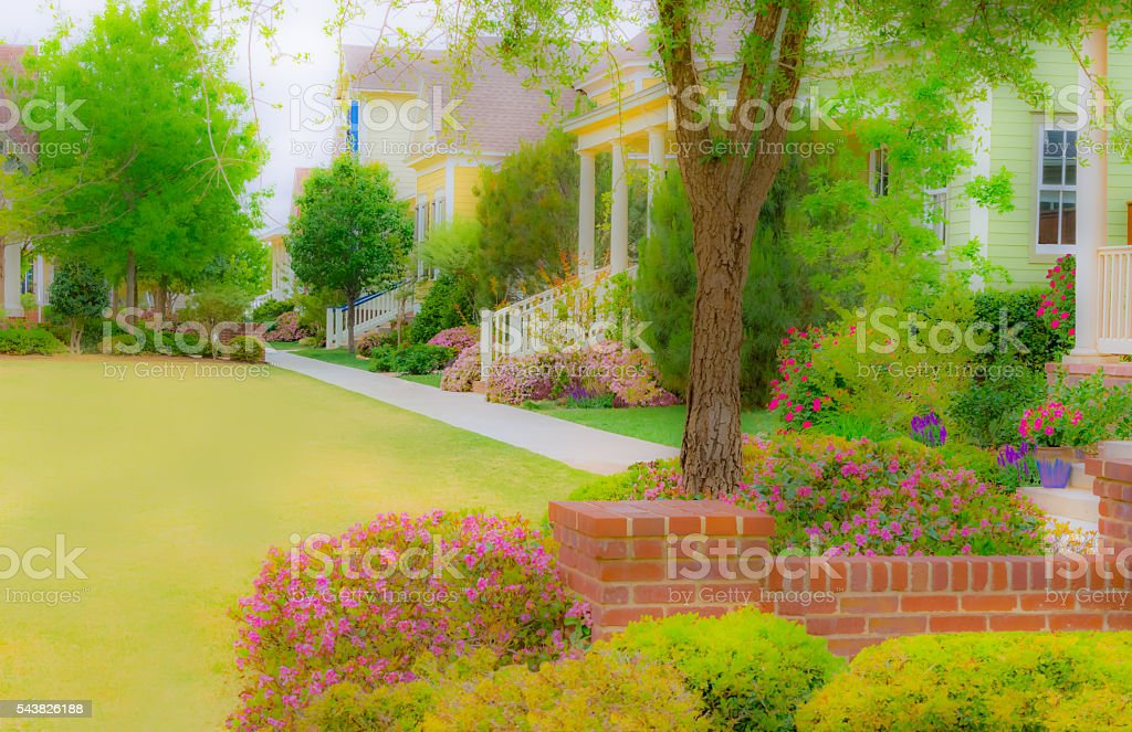 Old fashioned homes with gardens and porches on park (P) stock photo