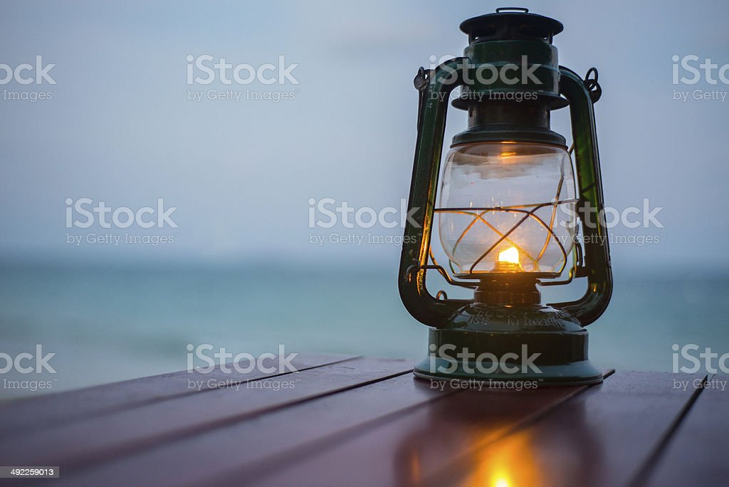 Old fashioned lantern in darkness. Light concept. stock photo