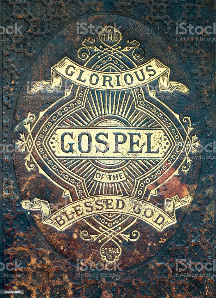 Old fashioned leather Gospel cover stock photo