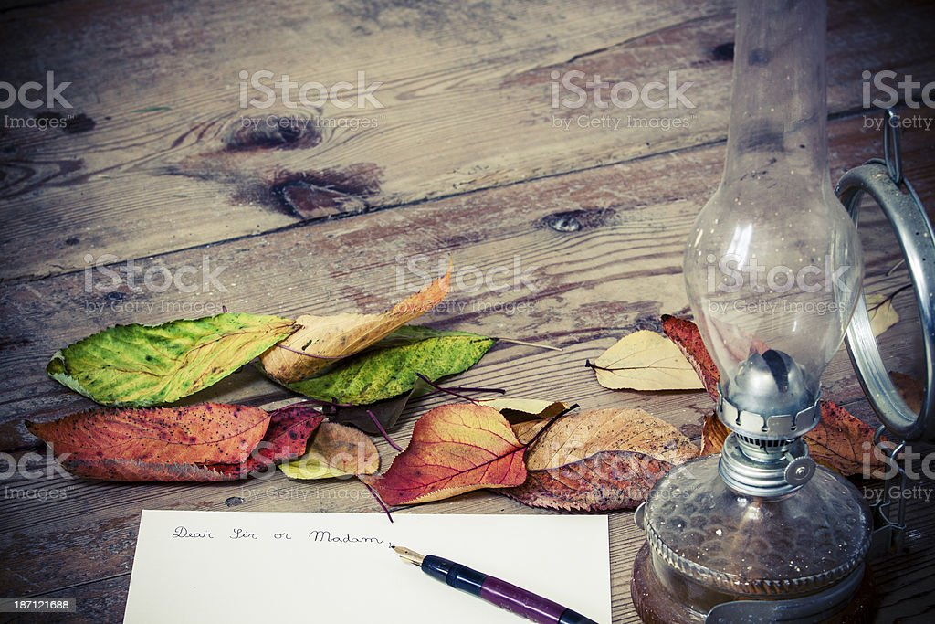 Old fashioned letter with a lamp and leafs royalty-free stock photo