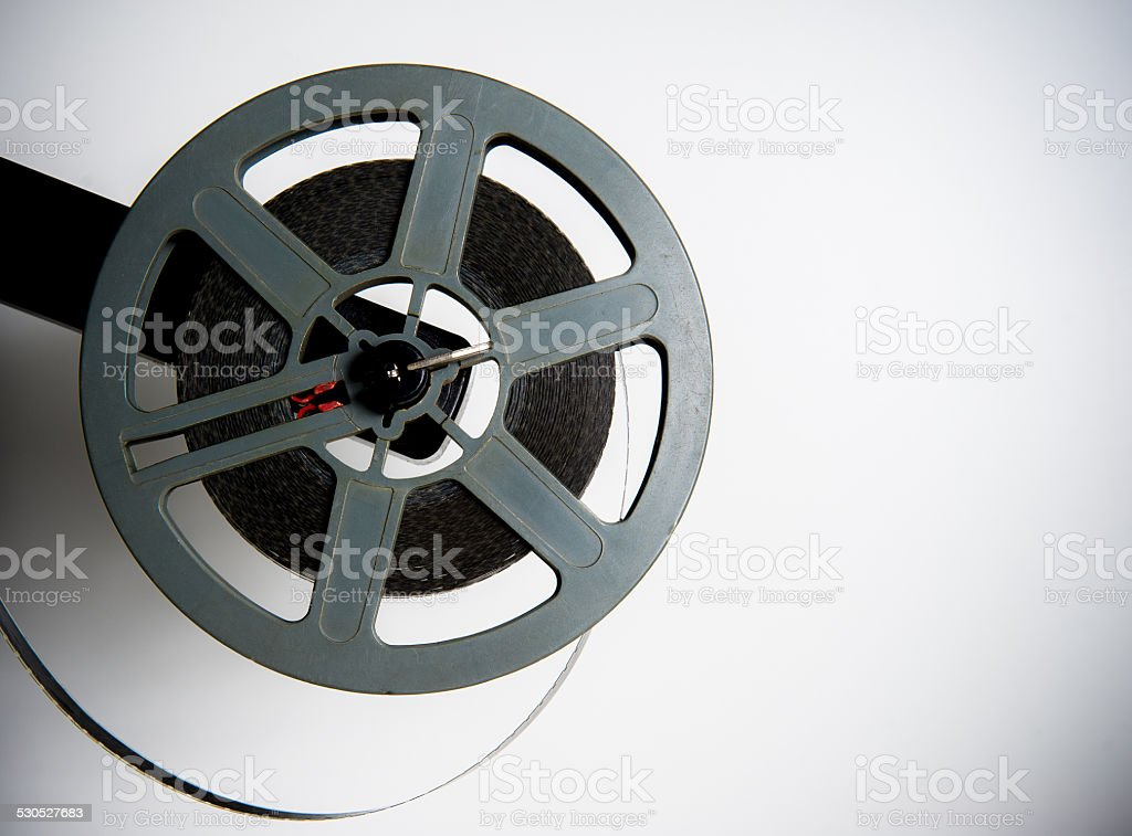 Old fashioned movie reel on white background stock photo