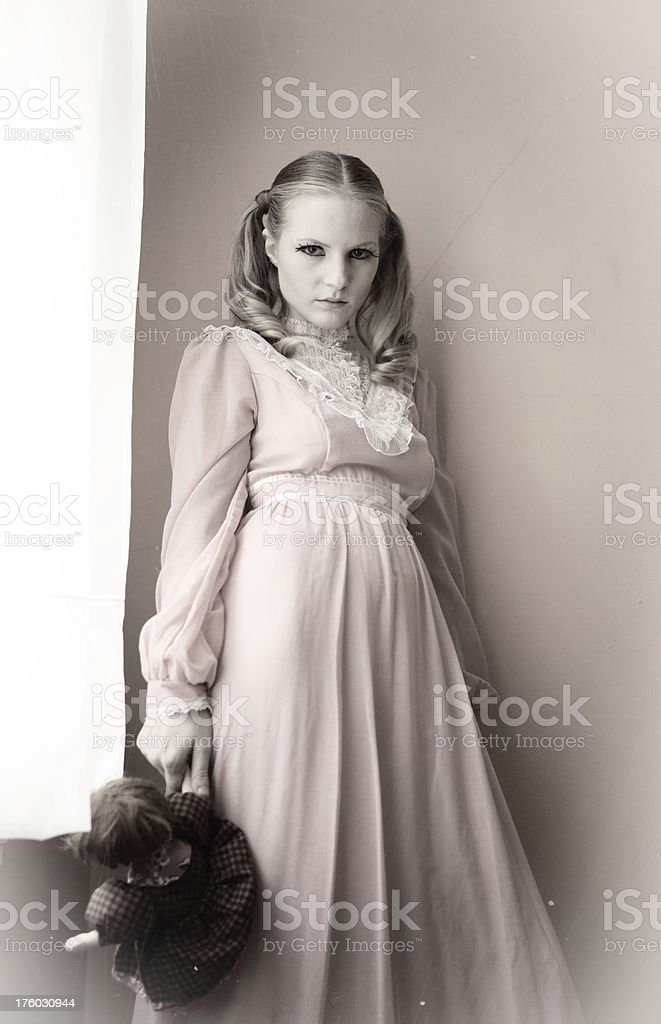 Old Fashioned Photo of Girl Holding Doll royalty-free stock photo