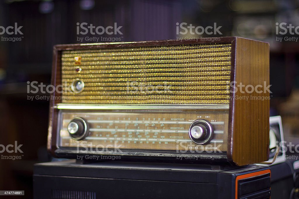 Old fashioned radio on flea market stock photo