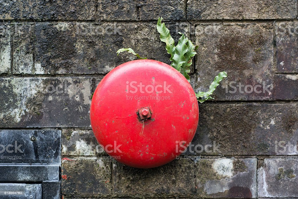 Old fashioned red alarm bell stock photo